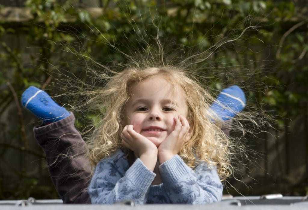 Boy on trampoline with static hair, no sunglasses